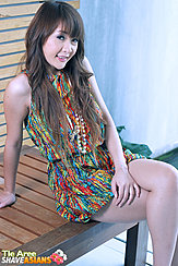 Seated On Bench Long Hair Falling Over Her Dress