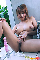 Seated Against Wall Big Breasts Bared Hand Between Her Spread Legs Over Her Shaved Pussy