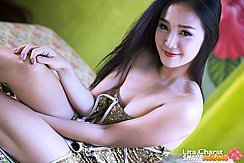 Lita Charat Seated On Bed Cheongsam Falling From Her Shoulders Hand On Knee Long Hair