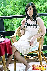 Shampoo Mei Seated At Table Wearing Dress Bare Feet