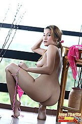June Tharita Squatting Beside Table Looking Over Her Shoulder Big Breast In Profile With Erect Nipple Panties Pulled Down Bare Ass Bare Feet