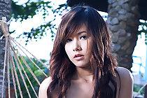 Pretty Miky Otaka stripping on hammock and fondling breasts