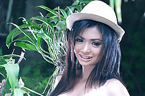 Busty Meena Yen strips dungarees while watering garden