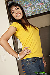 Standing With Hand On Hip Wearing Yellow Top
