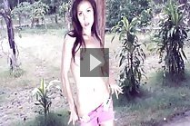 Long hair Tina Phawadee stripping denim shorts outdoors